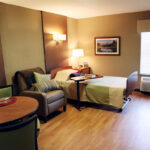a patient room at Bridgeport Healthcare Center with a single bed and chair