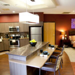 a kitchen connected to a bedroom at Copley Health Center
