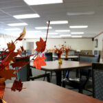 tables in a game room at Crestwood Care Center's dining room