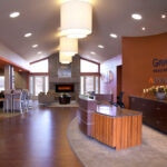 The front desk and fireplace at Greenbrier Health Center