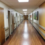 a hallway of patient rooms at Marley Neck Health And Rehabilitation Center