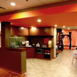 s kitchenette and seating area by Orange Spot Bistro