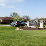 outside signage for Pebble Creek Healthcare Center and Advance 360