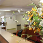 close up of bouquet of flowers on the front desk