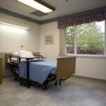 patient room with single bed at Harrison Healthcare Center