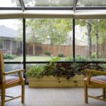 screened in sitting area overlooking a courtyard